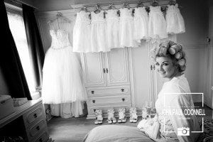 This picture is of a Bride getting ready in the house Black and White