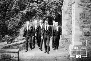 Groom and groomsmen walking to the camera Reportage