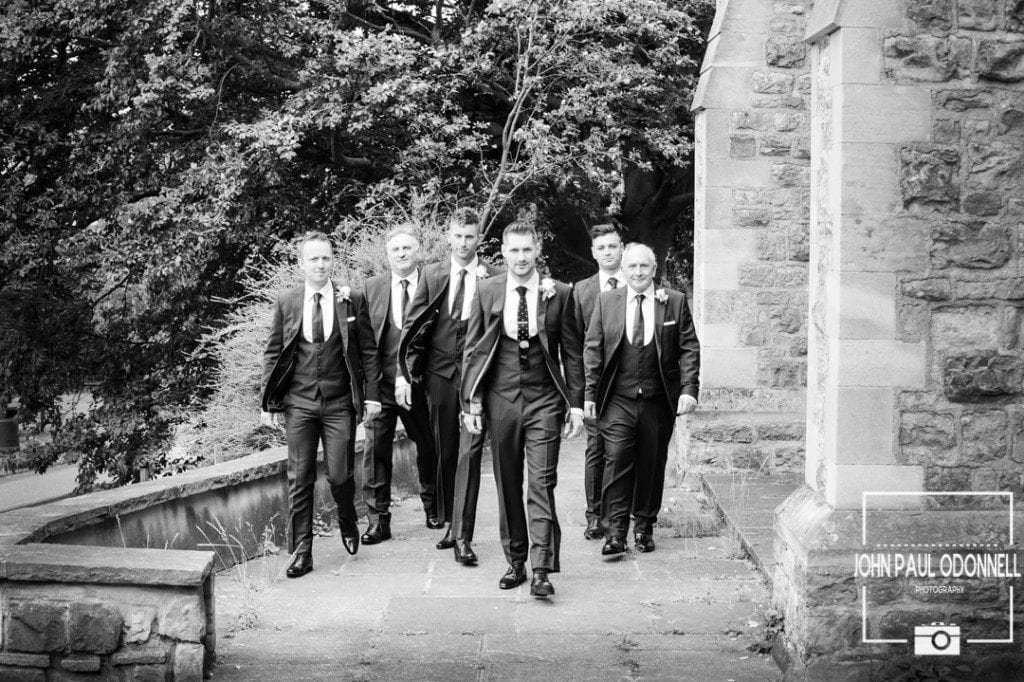 This is a Reportage picture of the groom and ushers arriving at the church just before the ceremony