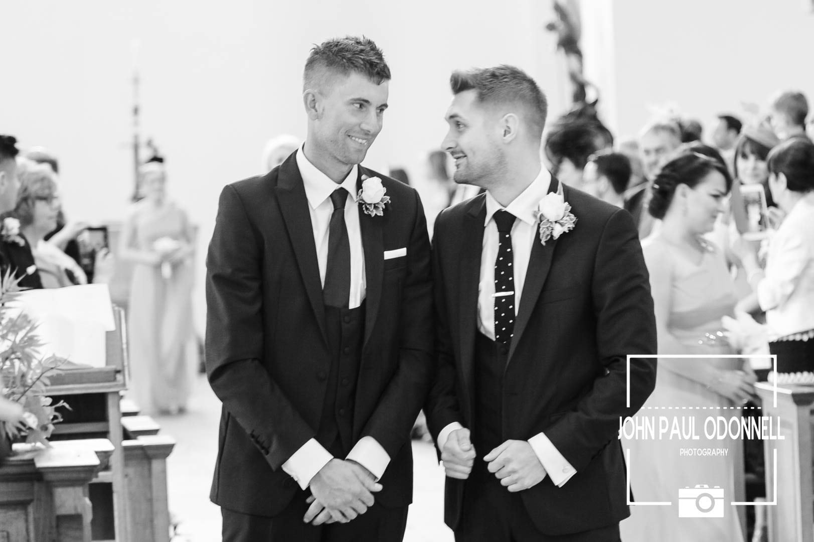 Groom and best man waiting for the bride at the church altar