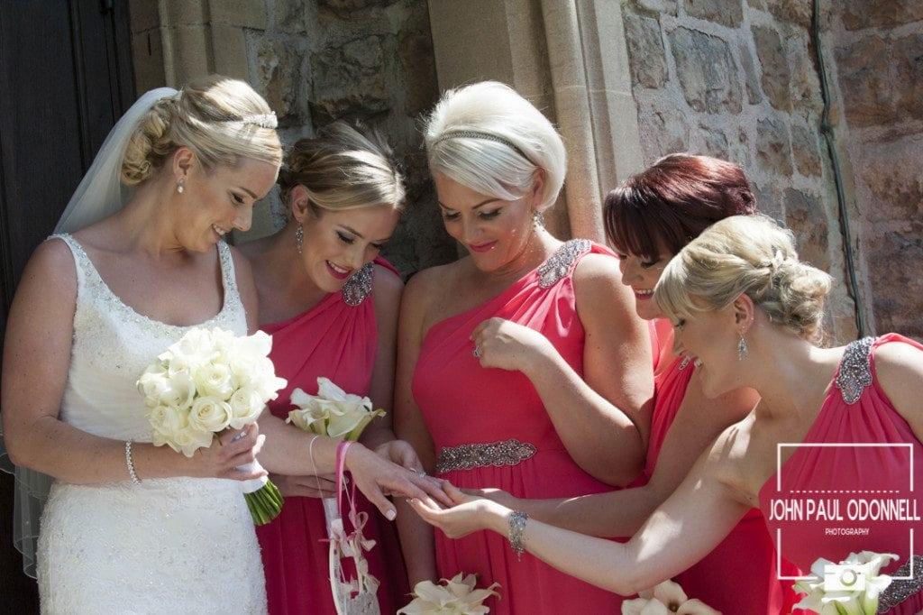 Reportage bridesmaids looking at the brides wedding ring