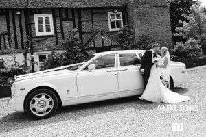 This picture is of the Bride and Groom with the wedding car at Newland Hall