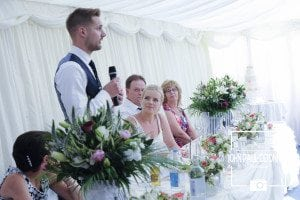 grooms speech at the top table photograh taken at Newland Hall