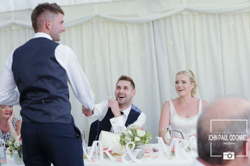 A Reportage picture of the Best man congratulating the Groom on his wedding day