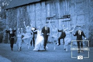 Fun jumping picture with the bridesmaids and ushers taken at Newland Hall