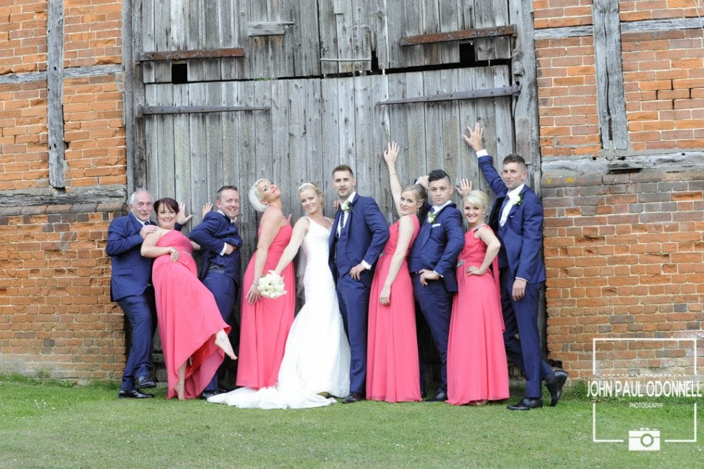 a Reportage fun groomsmen and bridesmaids photograph taken at Newland Hall