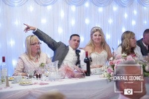 This is a picture of the Groom on his wedding day before the speeches start at top table