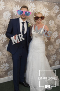 Bride and Groom Photo Booth with sunglasses and signs