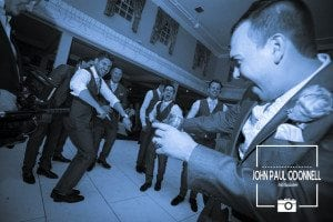 Groom and ushers dancing and having fun on the dance floor at his wedding