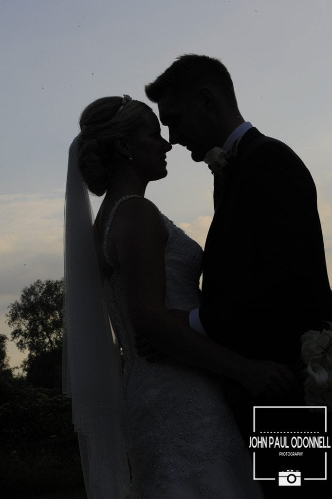 A Reportage sunset silhouette picture of a Bride and Groom