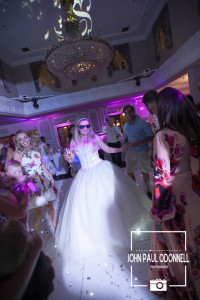 A beautiful picture of a bride on the dance floor with sunglasses on