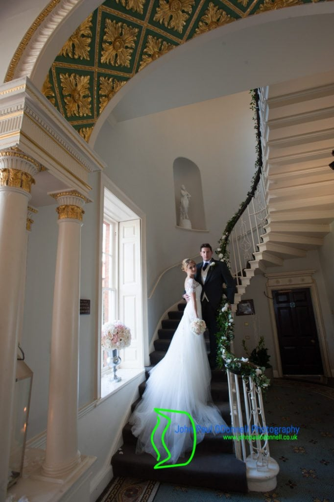 A Bride and Groom on the staircase at Theobalds Park