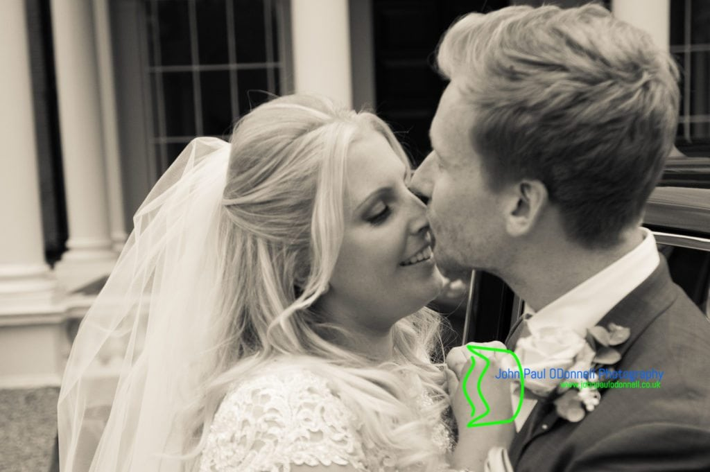 27 bride and groom kissing