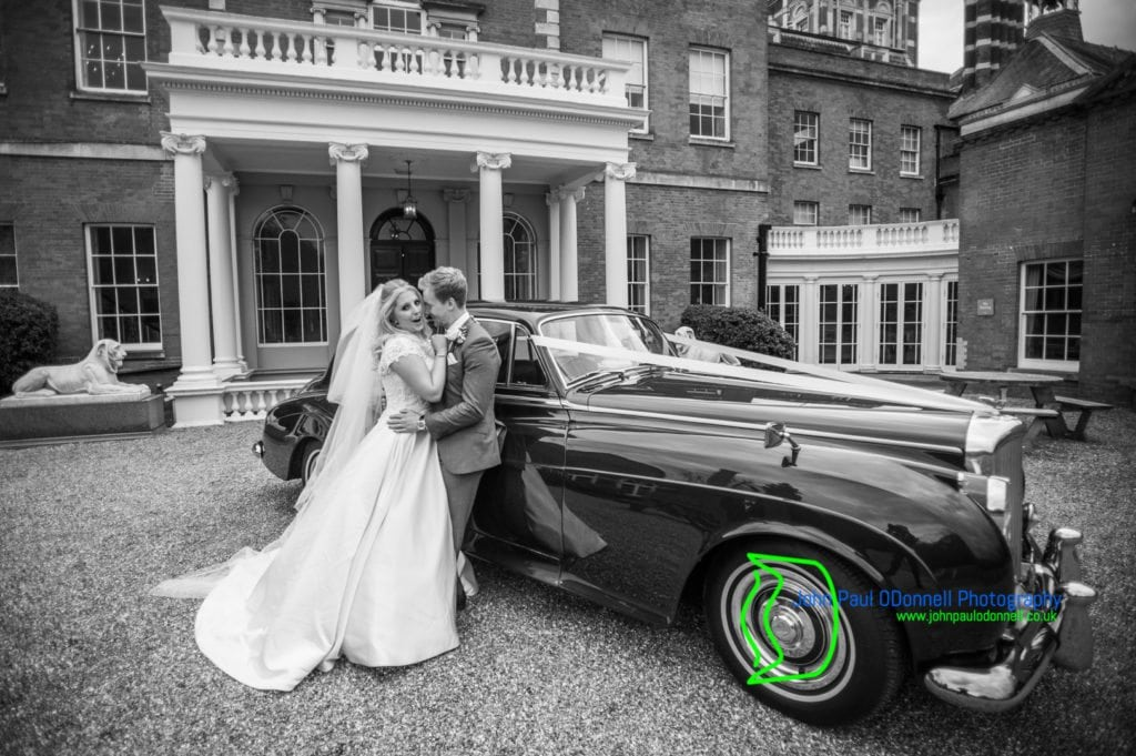 30 bride and groom with car Theobalds Park Mansion