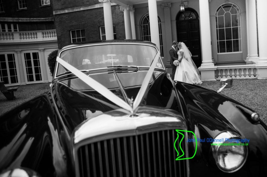 31 bride and groom with Bentley S1 Theobalds Park Mansion