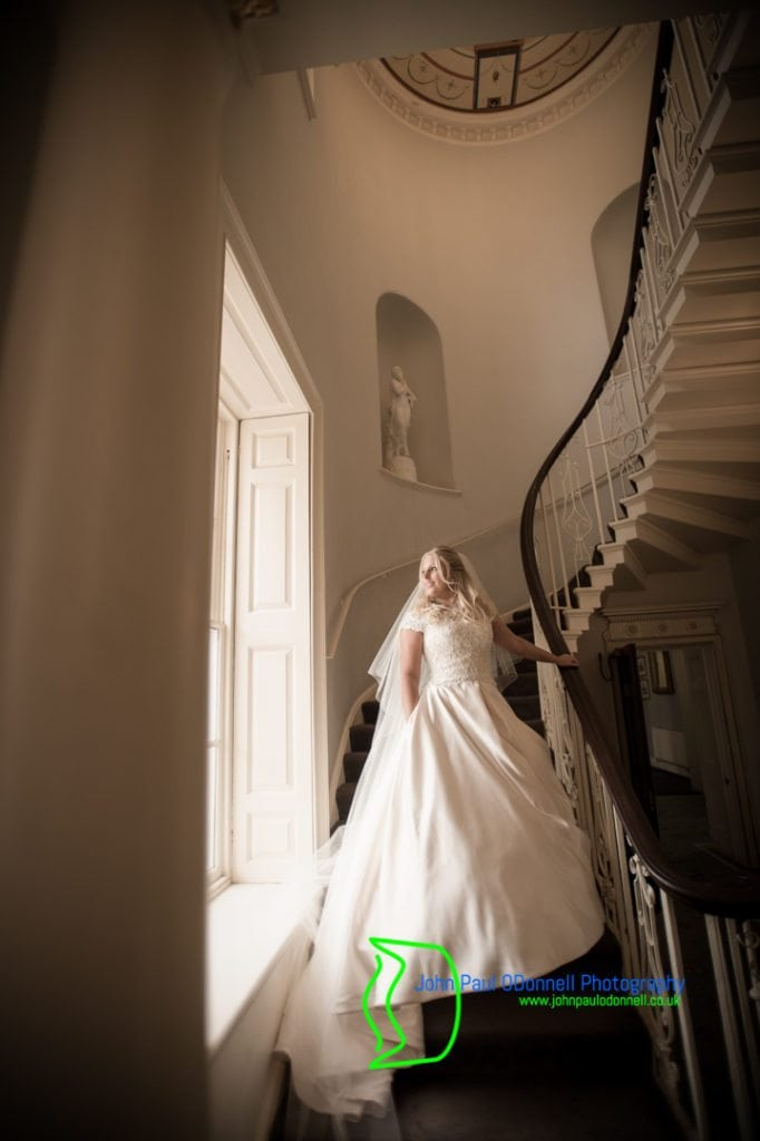 33 bride on staircase at Theobalds Park