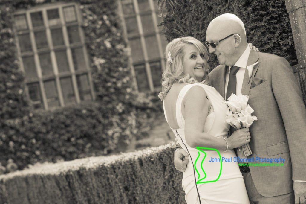 Bride and Groom in the Gardens at Fanhams Hall