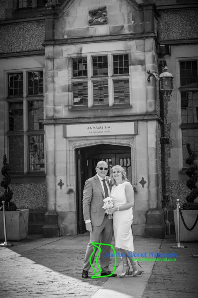 Bride and Groom in the Courtyard at Fanhams Hall