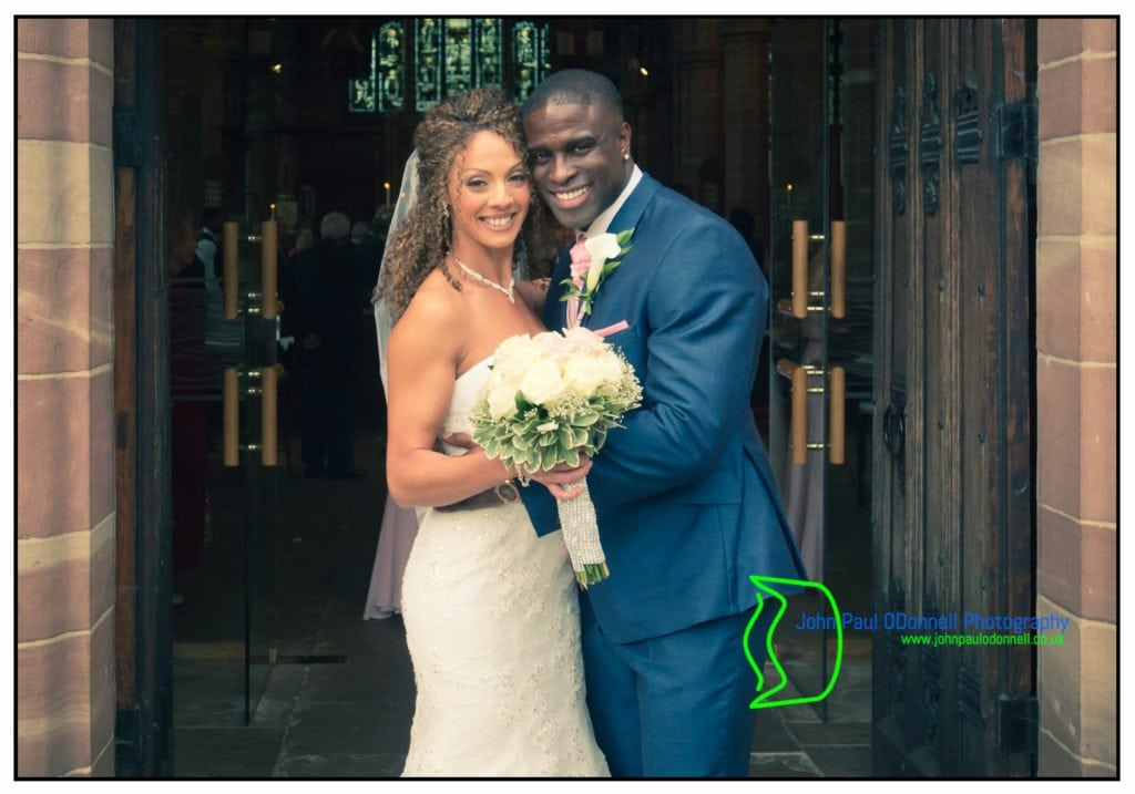 Carmen and Dwain - Hanbury Manor (4). Image of the Bride and Groom after the wedding Ceremony at All Saints Church Hertford Image by John Paul ODonnell