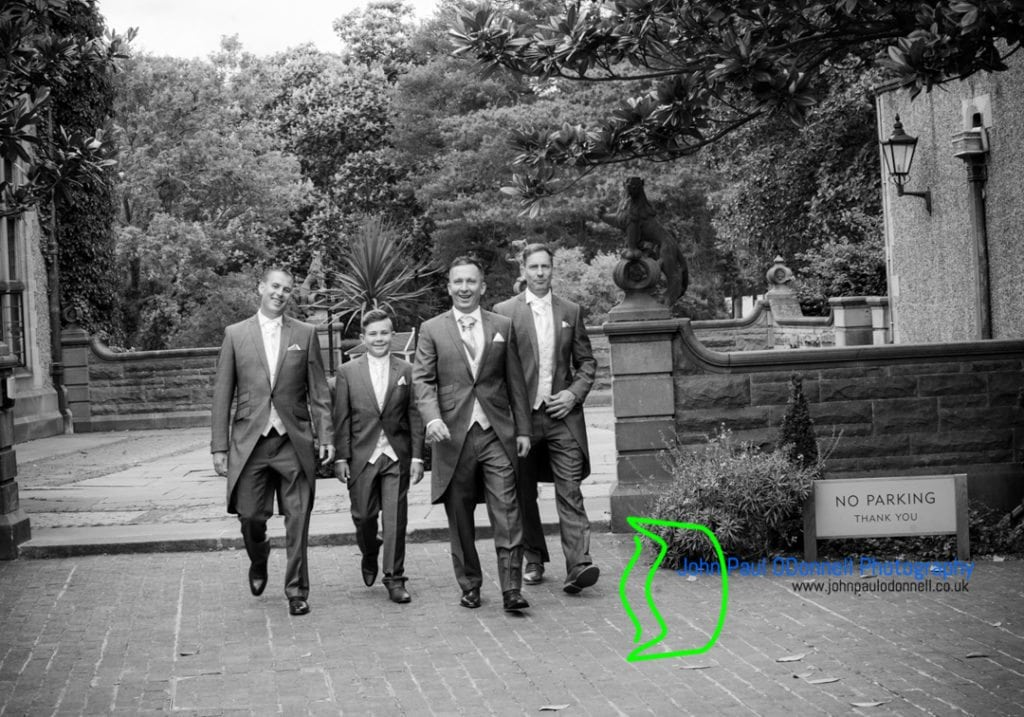 This is an image of the groom arriving at the hotel with the groomsmen before the wedding ceremony