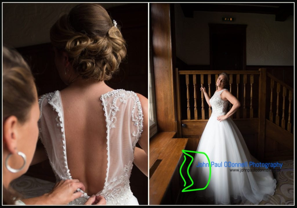This is an image of the bride getting into her wedding dress