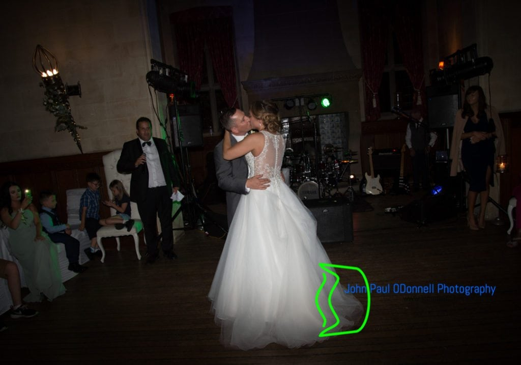 this image is of the bride and grooms the first dance