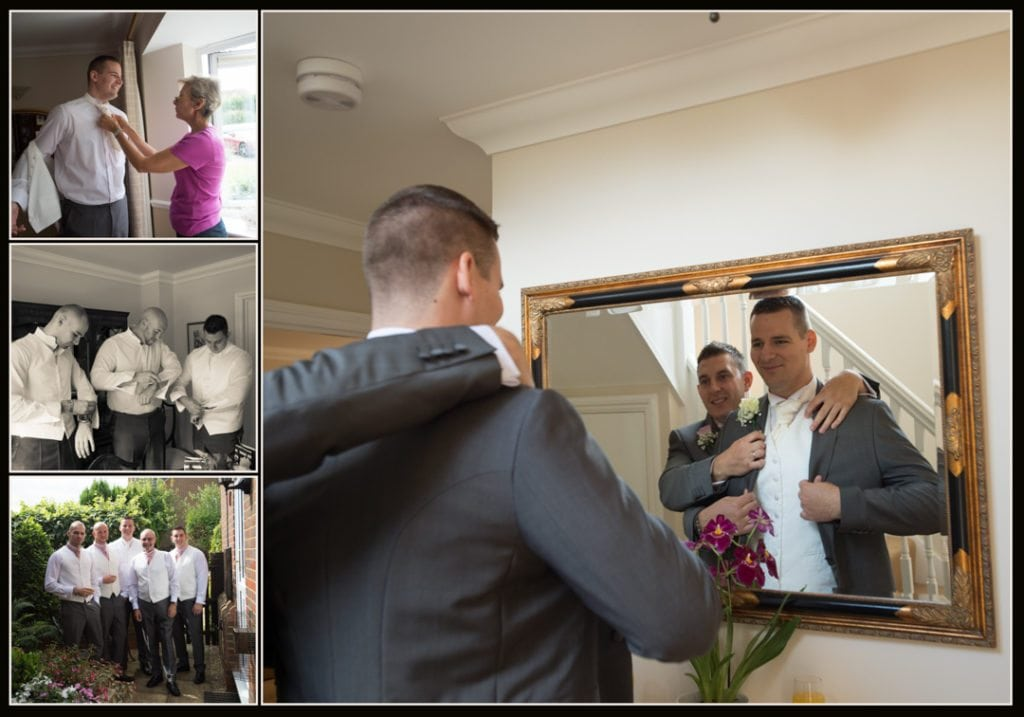 This image is of a groom getting in to his wedding suit at his parents house with the help of his best man