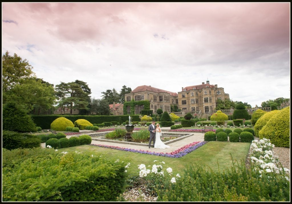 image is of the bride and groom in front of Fanhams Hall Hotel Hotel