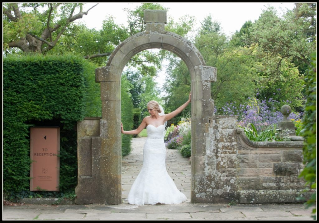 the bride in the main gardens at Fanhams Hall