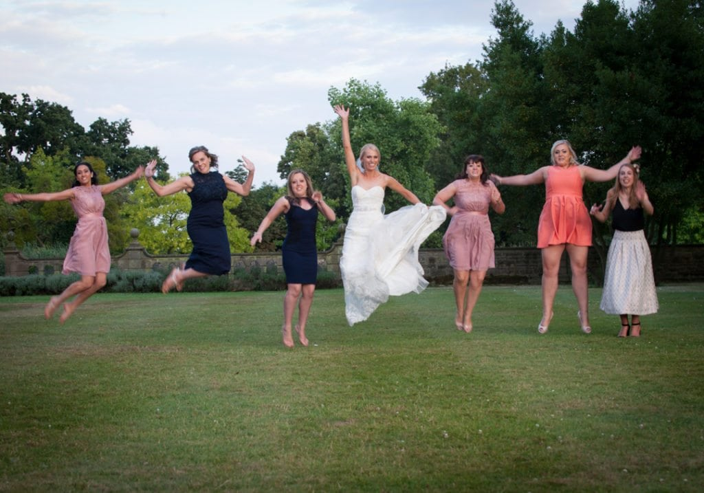 This is a image is of the bride and jumping up in the air