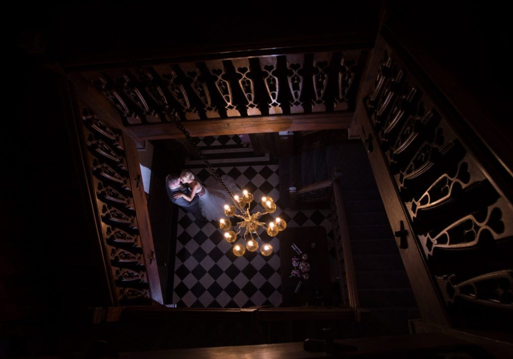 This is a image is of the bride and groom and is taken by the staircase