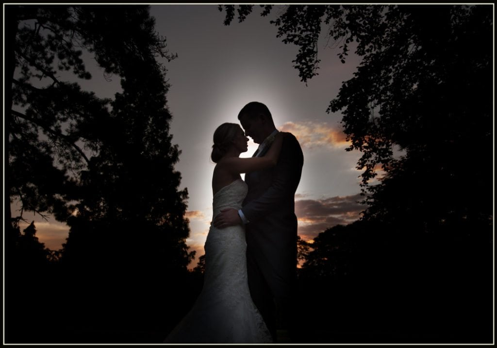 This is a image is of the bride and groom and is taken with the sun setting
