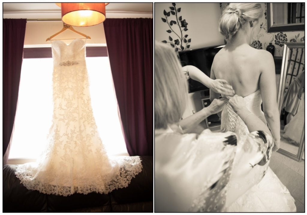 This image is of the bride getting into her wedding dress