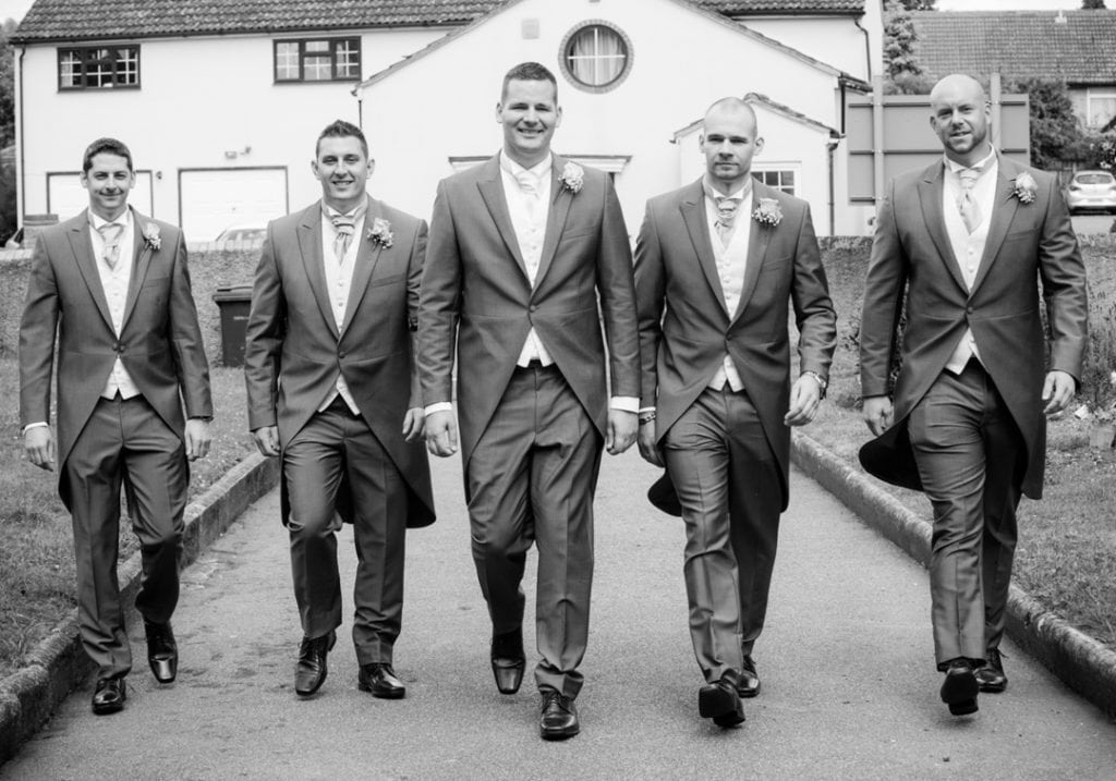 This image is of the groom and groomsmen arriving at the church
