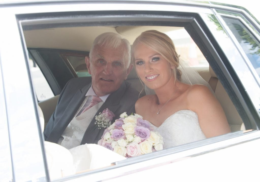 This image is of the bride and her dad arriving at the church