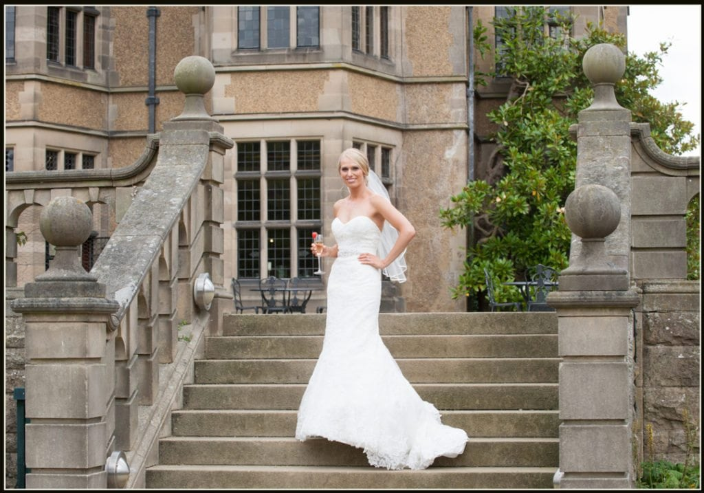 This image is of the bride standing at the top of the steps at Fanhams Hall