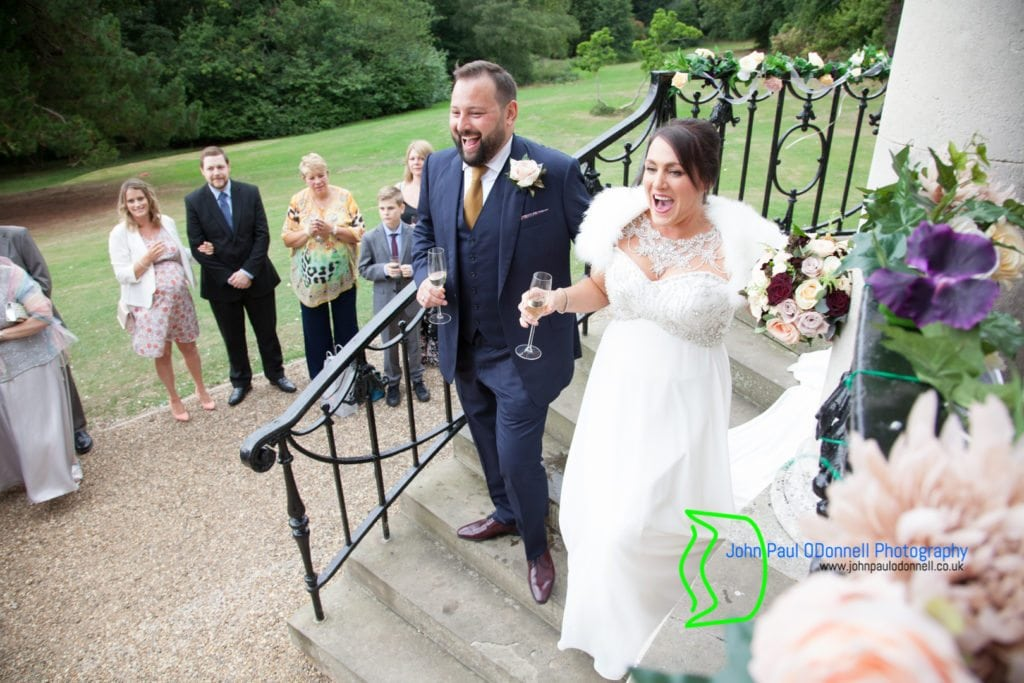 bride and groom coming down the steps at ponsbourne park