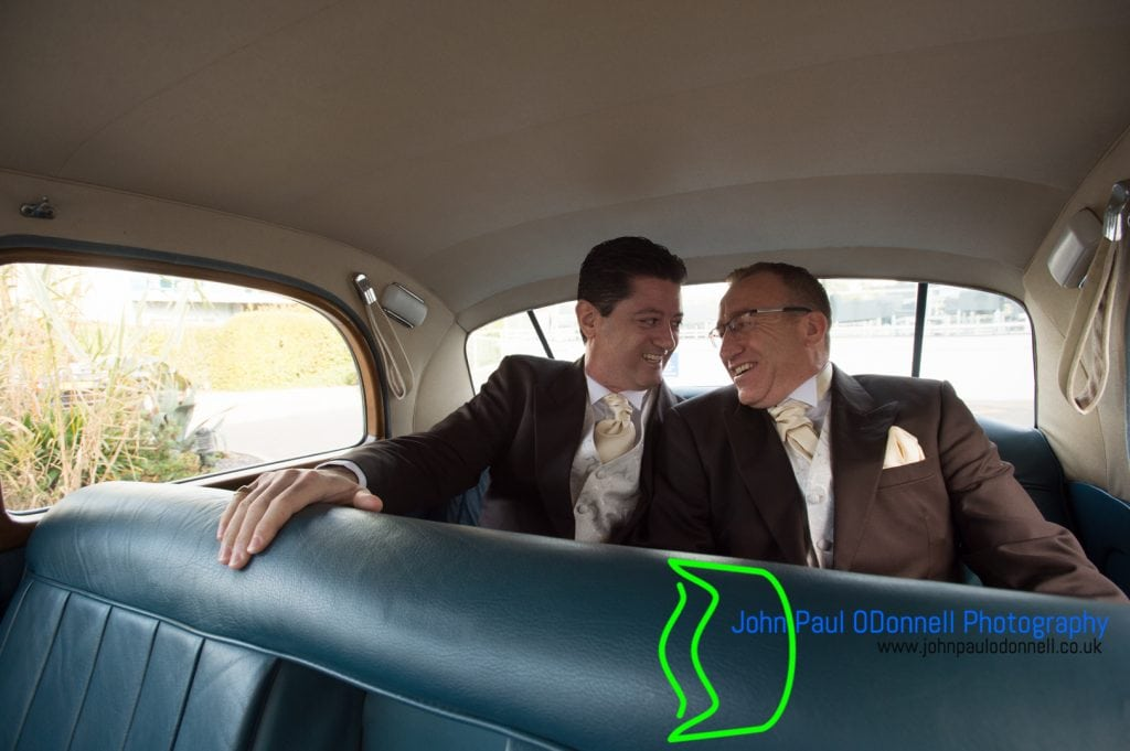 Groom inside the wedding car with best man