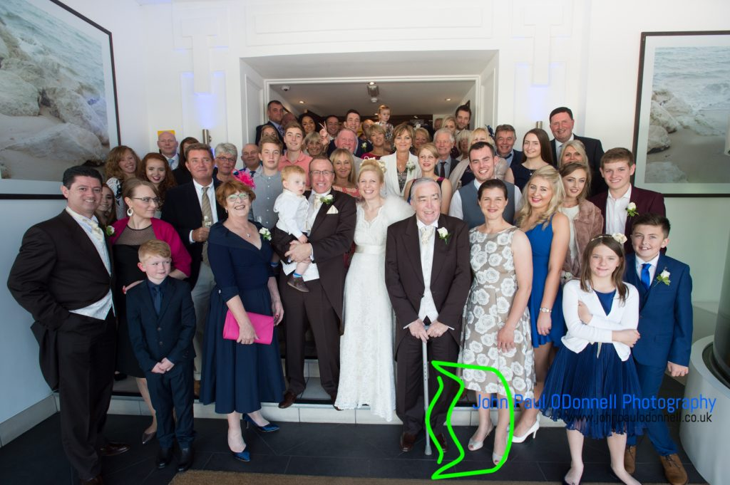 all the guests from the wedding with the bride and groom