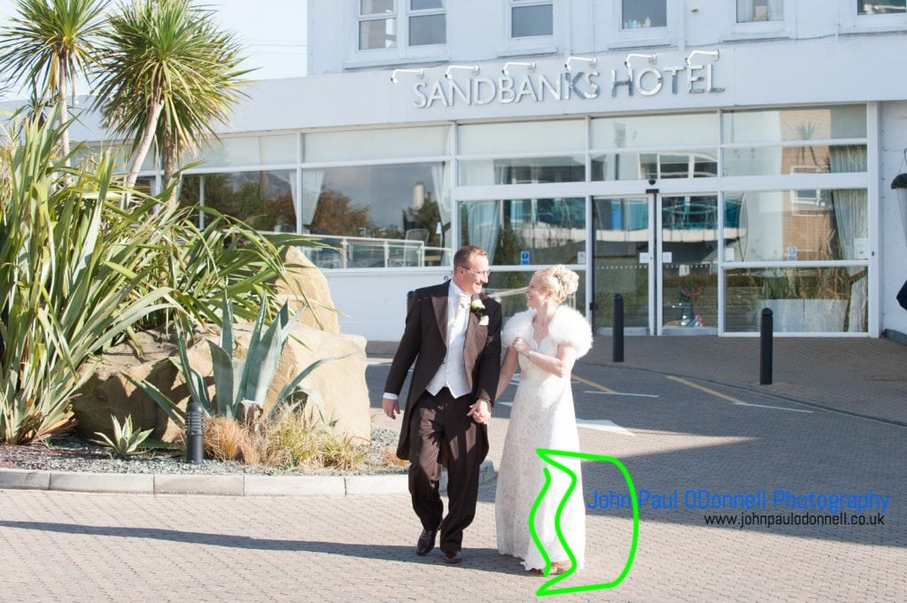 bride and groom walking at the hotel
