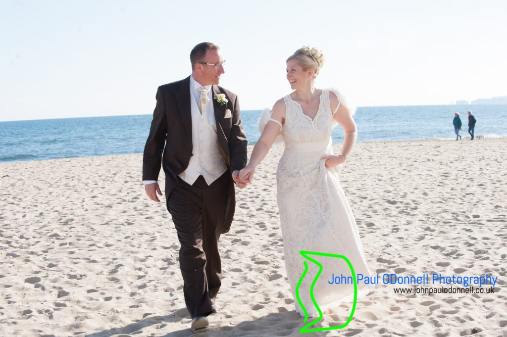 bride and groom by the sea at the beach