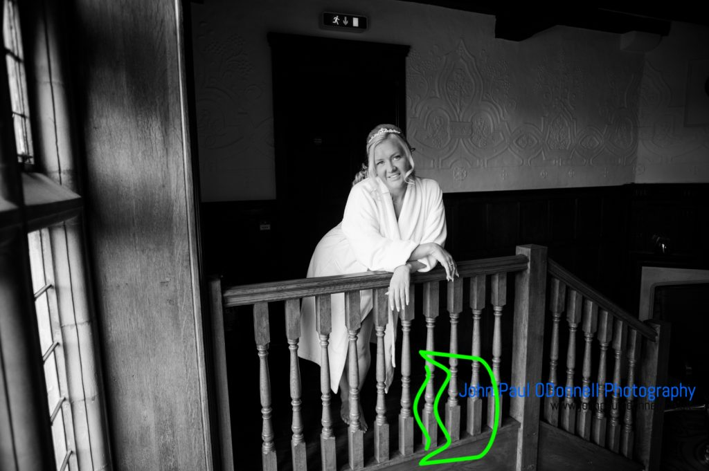 Image of a bride getting ready in the room at the hotel. She was just about to get into her wedding dress.