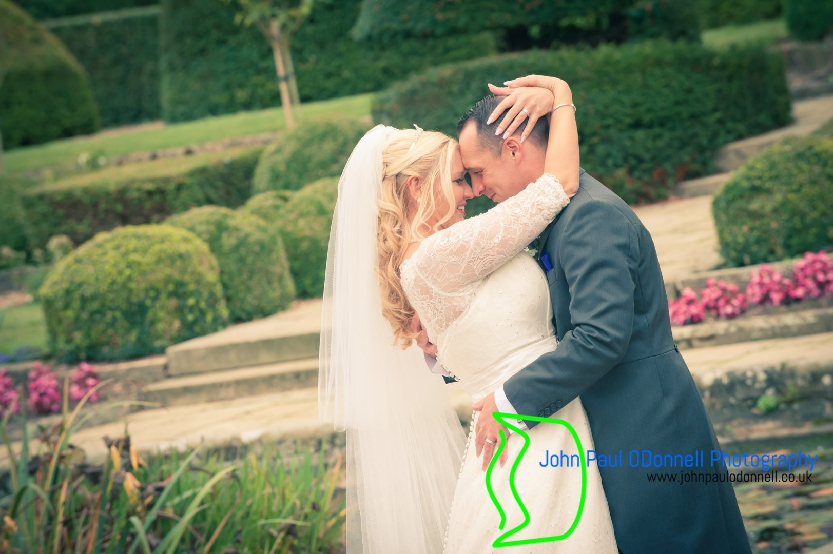 This image is of the bride and groom about to kiss on their wedding day in the beautiful gardens fanhams hall.