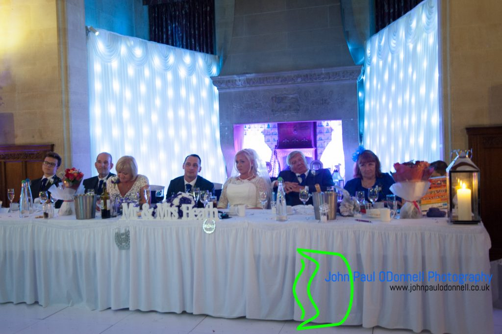 This image is of the bride and groom at the top table in the great hall at fanhams hall hotel