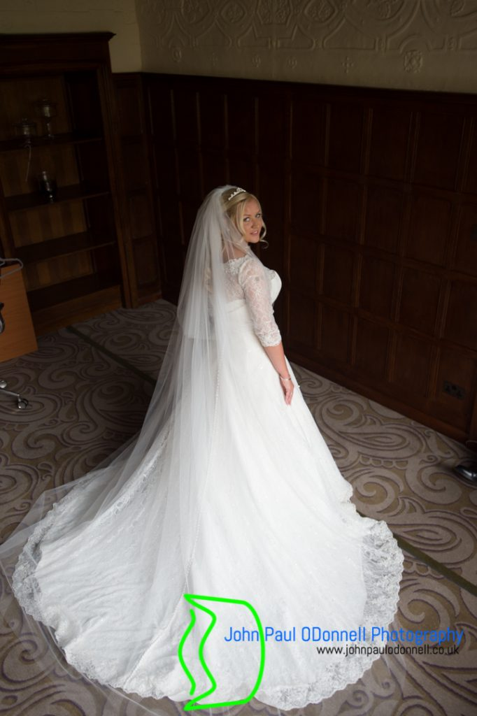 This is an image of the bride in her wedding dress at the hotel. She was just about to get into her wedding dress.