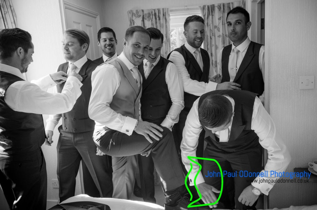 The groom getting ready with his groomsmen