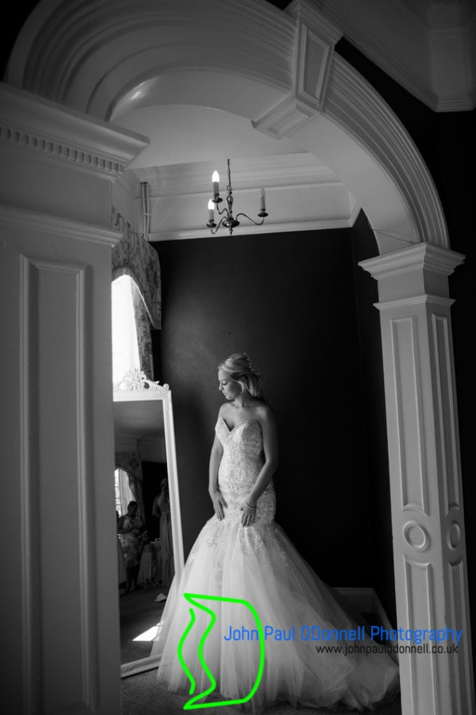 Bride in her dress in the bridal suite at mulberry house