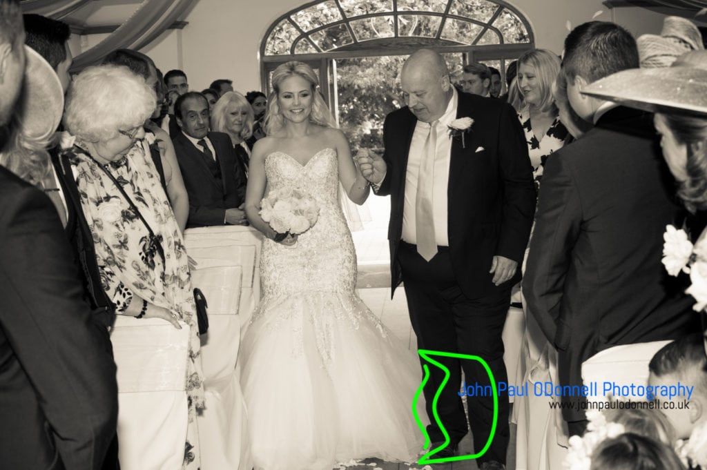 bride coming down the aisle with her dad in a ceremony at mulberry house
