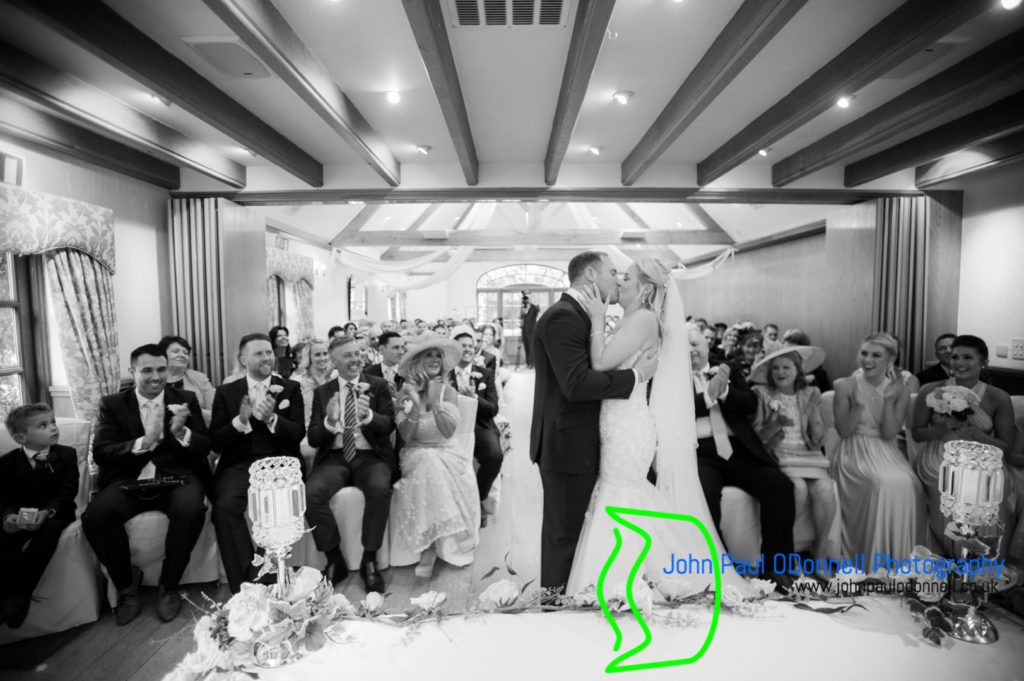 bride and groom kissing after the ceremony at mulberry house