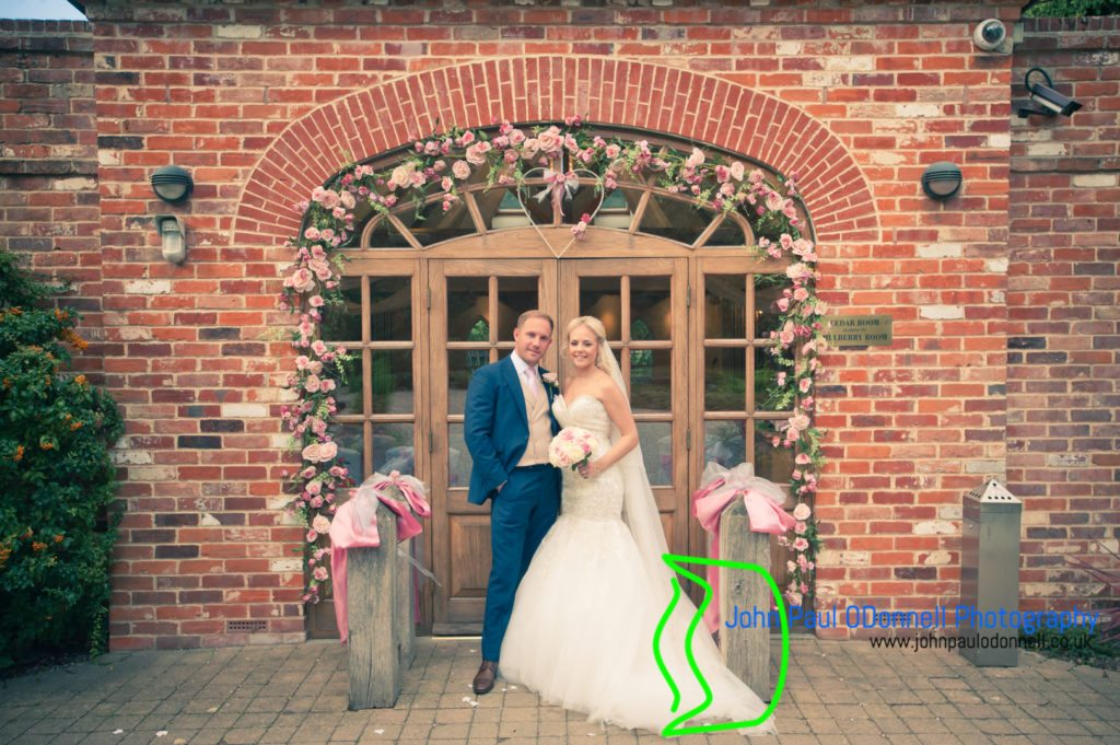 The bride and groom by the cedar room at mulberry house ongar essex